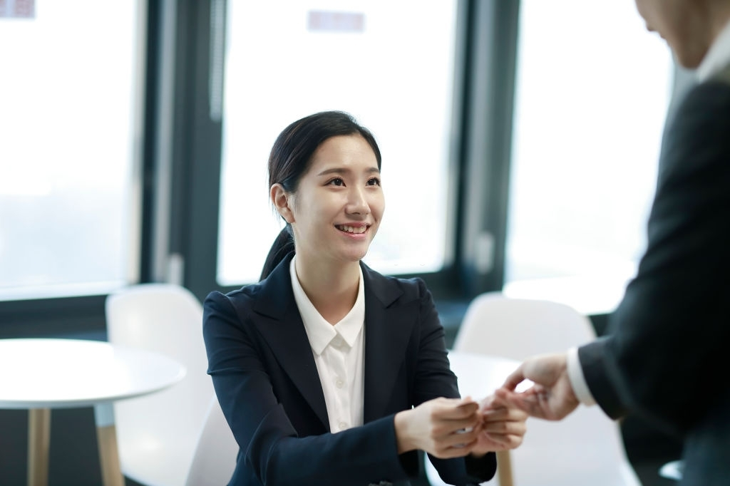 lady sharing her business card with client