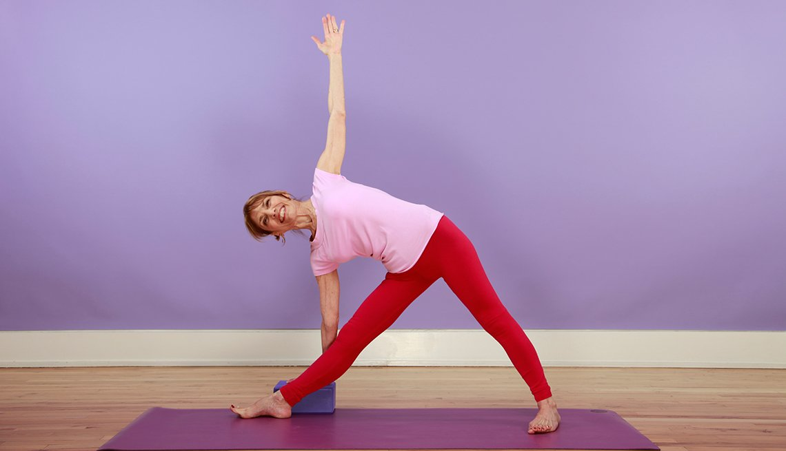 woman doing triangle pose